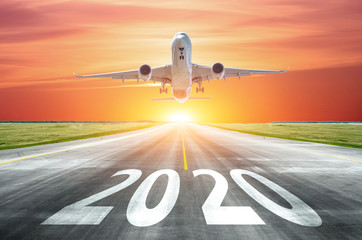 Türaufkleber Flugzeug The inscription on the runway 2020 surface of the airport runway with take off airplane. Concept of travel in the new year, holidays.