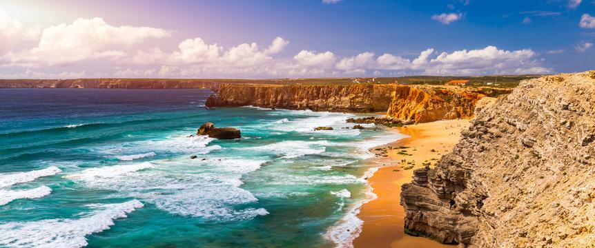 Panorama view of Praia do Tonel (Tonel beach) in Cape Sagres, Algarve, Portugal. Praia Do Tonel, beach located in Alentejo, Portugal. Ocean waves on Praia Do Tonel beach. View from Sagres fortress.