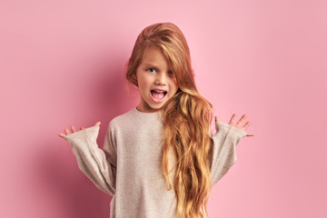 Portrait of surprised caucasian girl with sweet appearance look at camera, have long hair with long waves, wearing white blouse, isolated pink background