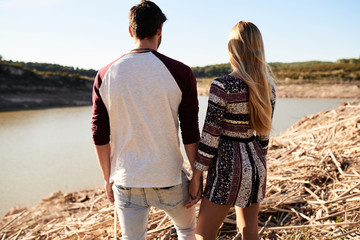 Romantic couple watching river landscape