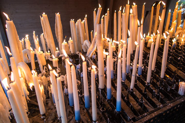 lit candles at the Marian shrine in Lourdes