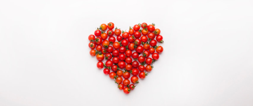 Heart shaped cherry tomatoes isolated on white