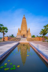 Mahabodhi Temple or Bodh Gaya Pagoda at Wat-Panyanantaram sunrise and beautiful sky, Wat Panyanantaram is famous pagoda and popular for traveler near bangkok at Pathum Thani, Thailand