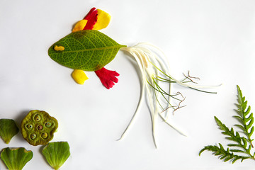 Charming image of sea fish and seaweeds created with tropical botanical materials