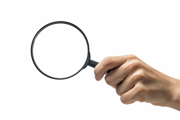 Female hand holding the magnifying glass on isolated white background.