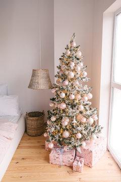 Christmas bedroom interior with Christmas tree and lights.