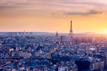 Panoramic aerial view of Paris, Eiffel Tower and La Defense business district. Aerial view of Paris at sunset. Panoramic view of Paris skyline with Eiffel Tower and La Defense. Paris, France.