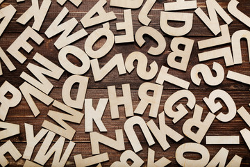 Wooden letters on brown table