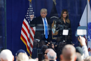 U.S. President Donald Trump and first lady of the United States Melania Trump gesture as they exit a Veterans Day Parade and Wreath Laying ceremony in Manhattan, New York City