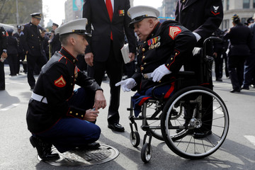 Lance Corporal James Duggan, 23, of the United States Marine Corps speaks with Sergeant Michael Sulsona before the Veterans Day Parade in Manhattan, New York