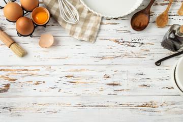 Baking pastry background frame, ingredients, kitchen utensils on rustic wooden background