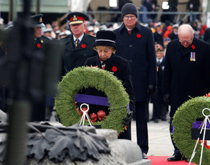 Silver Cross Mother Reine Dawe lays a wreath at the National War Memorial on Remembrance Day in Ottawa