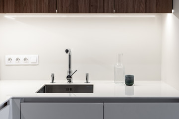 Modern sink with water tap in new contemporary kitchen