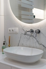 Modern basin with water tap in new contemporary bathroom