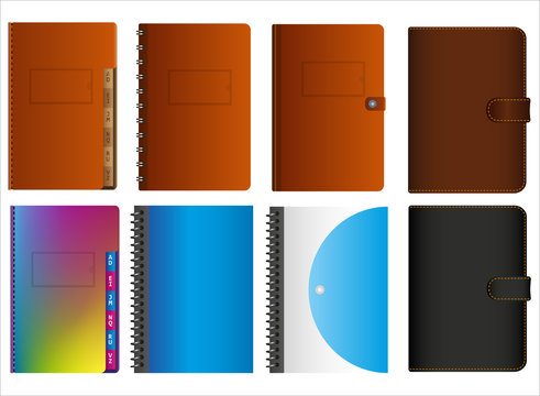 Set of isolated leather and plastic notebooks