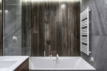 White and modern bath in new contemporary bathroom