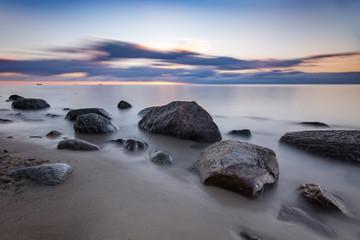 Fototapeta Wschód słońca na plaży w Gdyni, Morze Bałtyckie, Polska obraz