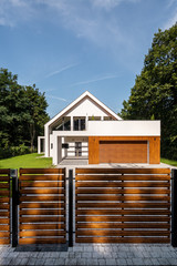 Designed house with fence