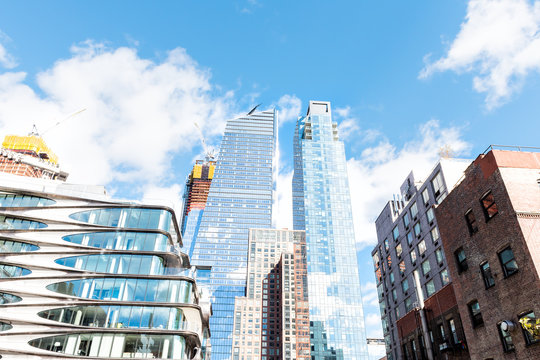 New York City, USA - October 30, 2017: Modern glass skyscrapers apartment residential buildings in NYC by high line highline in Chelsea West Side by Hudson Yards