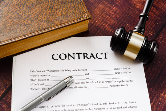 Legal contracts are subject to commercial disputes resolved in the courts of justice, contract with gavel.