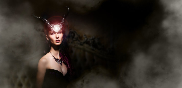 mystery young woman with horns on dark setting
