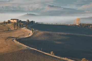 Fotorollo Dunkelgrau Tuscan landscape at sunrise under the fog