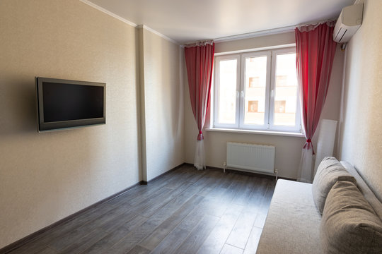 Interior of a modest room in an apartment for rent