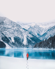 Person at Lake Plansee in Austria during Winter