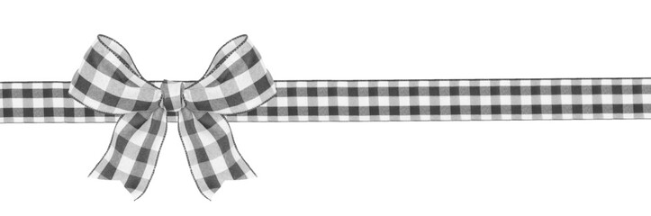 Black and white buffalo plaid Christmas gift bow and ribbon long border isolated on a white...