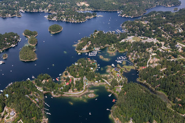 Fototapete - Sunshine Coast, British Columbia, Canada. Aerial View of Beaver Island and Madeira Park during a sunny and hazy summer morning.