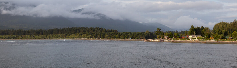 Wall Mural - Port Renfrew, Vancouver Island, BC, Canada. Beautiful Panoramic View of a beach in a small town during a cloudy summer sunset.