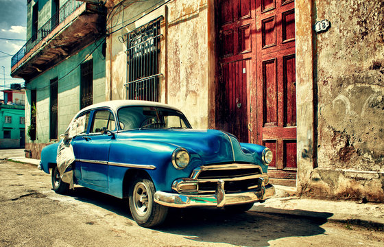 Old classic car parked in a street of Havana city
