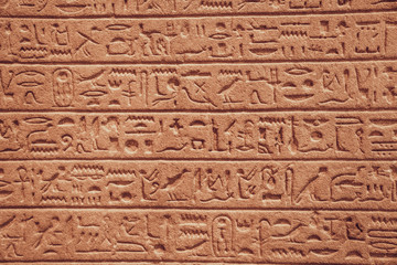 close up of Egyptian hieroglyphs on the wall