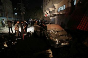 People gather at the scene of an Israeli strike that killed Islamic Jihad field commander Baha Abu Al-Atta in Gaza City