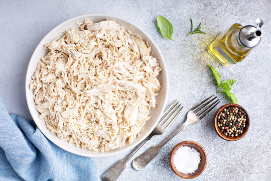 Shredded chicken meat in a big bowl