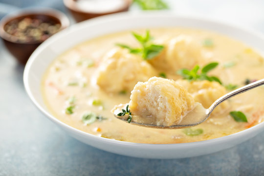 Chicken dumplings soup with cream and thyme