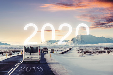 New year and new achievements concept. Group of car driving on the road heading to 2020 with 2019 on the road