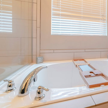 Square Contemporary spa bath with wooden tray caddy