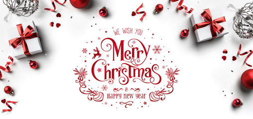 Merry Christmas and New Year text on white background with gift boxes, ribbons, red decoration, bokeh, sparkles and confetti. Xmas greeting card, bokeh, light. Flat lay, top view Fototapete