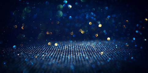 Fototapete - background of abstract glitter lights. blue, gold and black. de focused