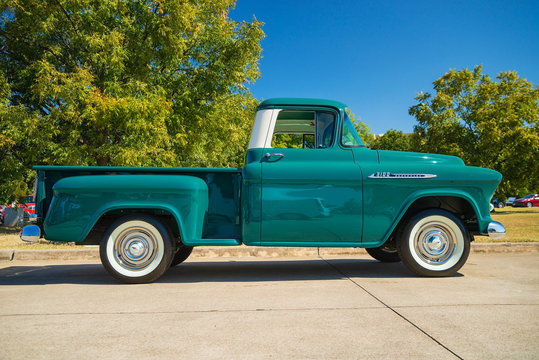 Full side view of a green vintage 1956 Chevrolet Apache 3100 classic truck on October 19, 2019 in Westlake, Texas.