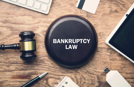 Wooden judge gavel with a other objects. Bankruptcy Law