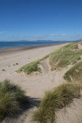 Fototapete - Harlech beach north west Wales UK by the castle