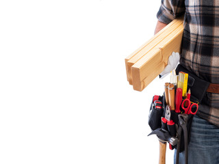 Carpenter isolated on a white background; he wears leather work gloves, he is holding wooden boards. Work tools industry construction and do it yourself housework. Stock photography. Text space.