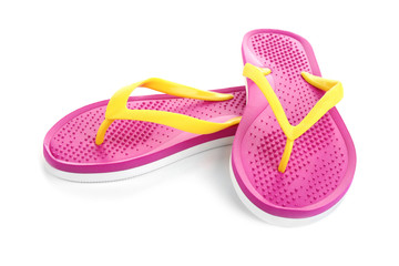 Stylish pink flip flops isolated on white