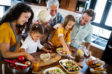 Portrait of happy family in kitchen at home