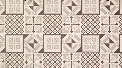 White and brown geometric azulejo tile wall texture background