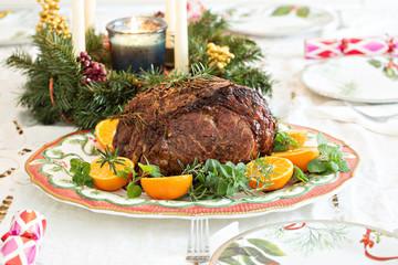 Holiday Christmas prime rib beef roast on the table
