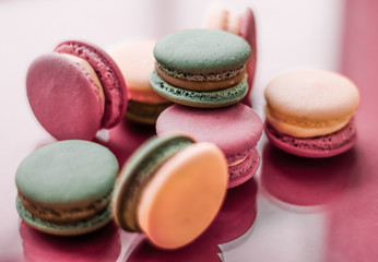French macaroons on pastel pink background, parisian chic cafe dessert, sweet food and cake macaron for luxury confectionery brand, holiday backdrop design Wall mural