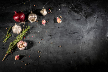 Fresh garlic and onion on dark background. Spices ingredients spicy food Asian, top view